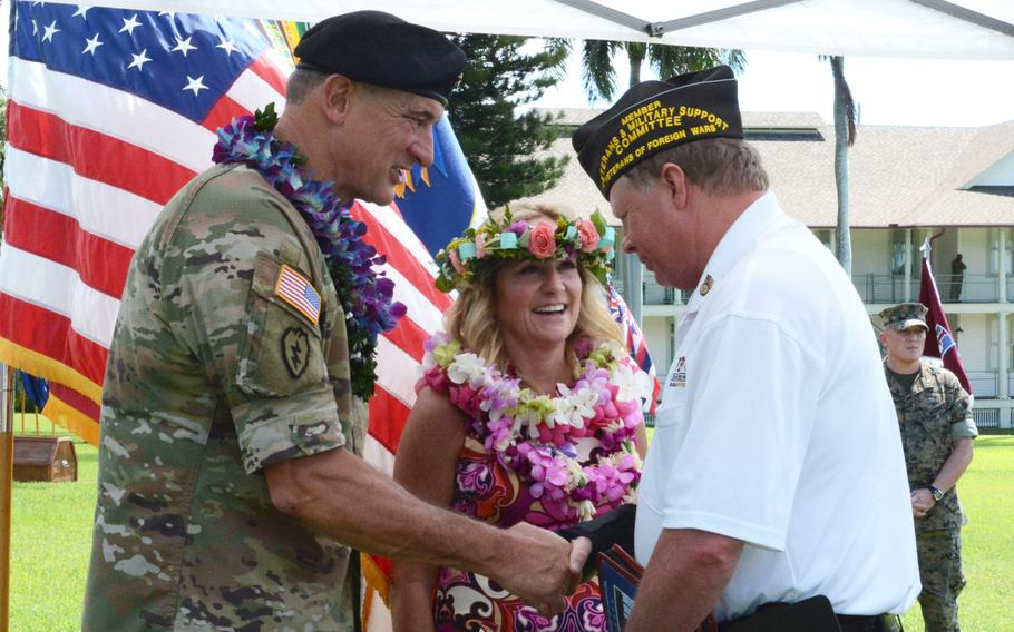 Gen. Robert Brown, commander of U.S. Army Pacific, and his wife Patti, greet Joseph Bragg Friday, Sept. 27, 2019, after the general's farewell ceremony at Fort Shafter, Hawaii.