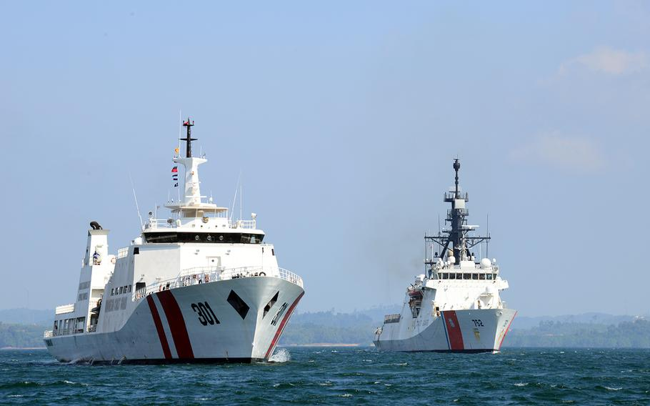 The Coast Guard cutter Stratton, right, sails alongside an Indonesian coast guard vessel in the Singapore Strait, Aug. 11, 2019.