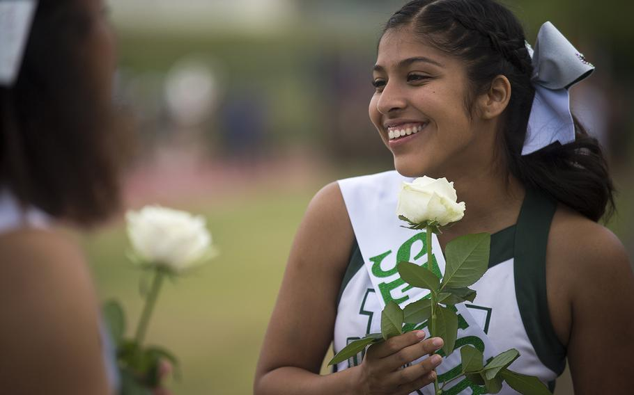 A senior cheerleader from Kubasaki High School speaks with her classmates ahead of the Dragons' homecoming matchup with the Camp Humphreys Blackhawks at Camp Foster, Okinawa, Friday, Oct. 25, 2019.
