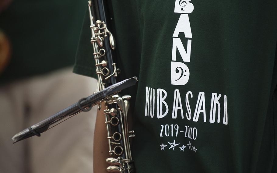 A player for the Kubasaki High School band plays during a game between the Dragons and Humphreys Blackhawks at Mike Petty Stadium on Camp Foster, Okinawa, Japan, Friday, Oct. 25, 2019.