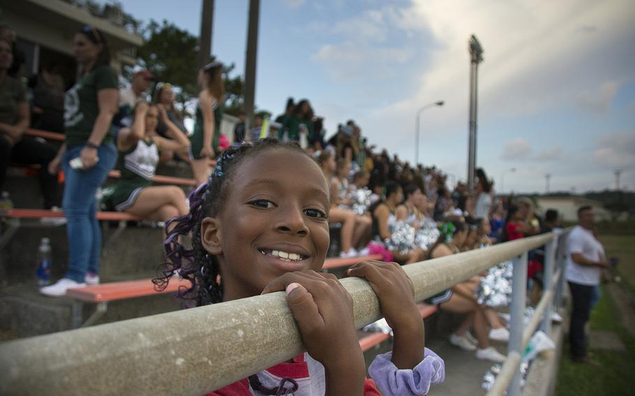 A young fan poses for a photo as Kubasaki High School hosts the Camp Humphreys Blackhawks at Camp Foster, Okinawa, Friday, Oct. 25, 2019.