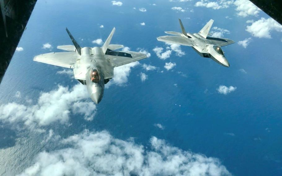 A pair of Air Force F-22 Raptors fly above the Coral Sea during the Talisman Sabre exercise, July 19, 2019.