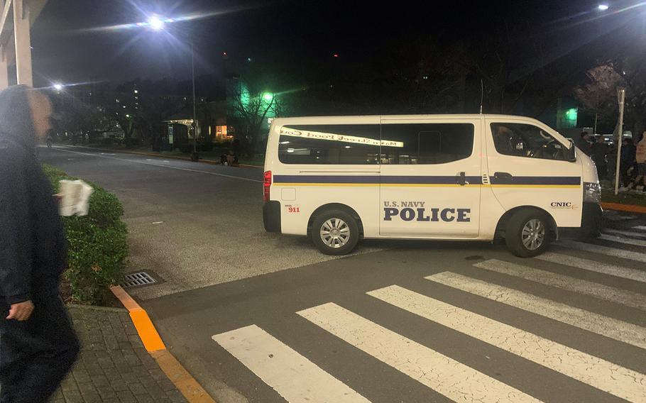 Navy police secure an area near a barracks for unaccompanied sailors after a bomb threat at Yokosuka Naval Base, Japan, Wednesday, Nov. 6, 2019.
