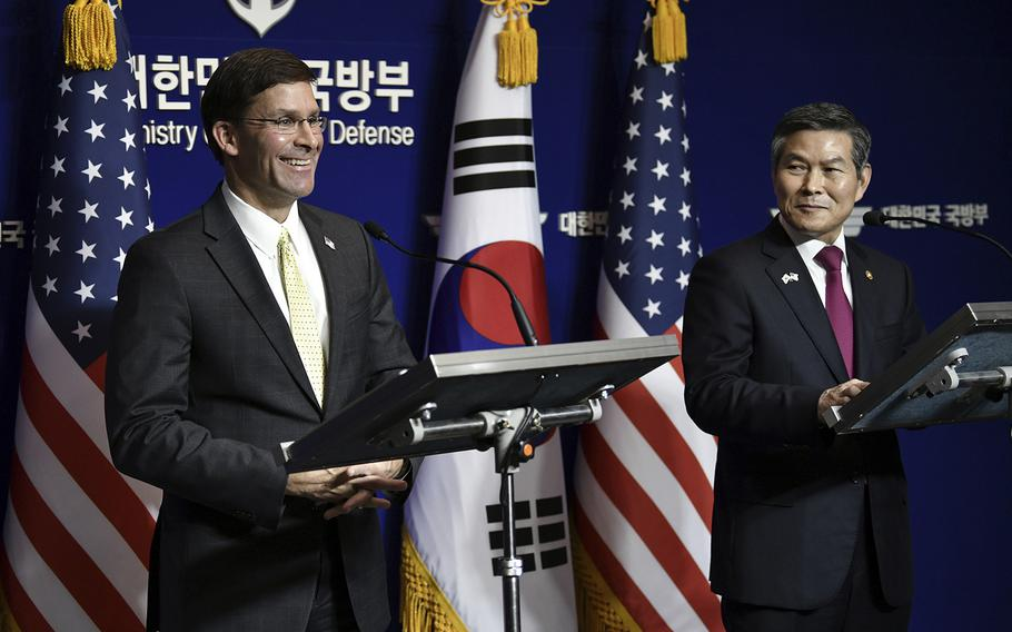 U.S. Defense Secretary Mark Esper, left, and South Korean Defense Minister Jeong Kyeong-doo, right, hold a joint press conference after the 51st Security Consultative Meeting at the Defense Ministry in Seoul Friday, Nov. 15, 2019.