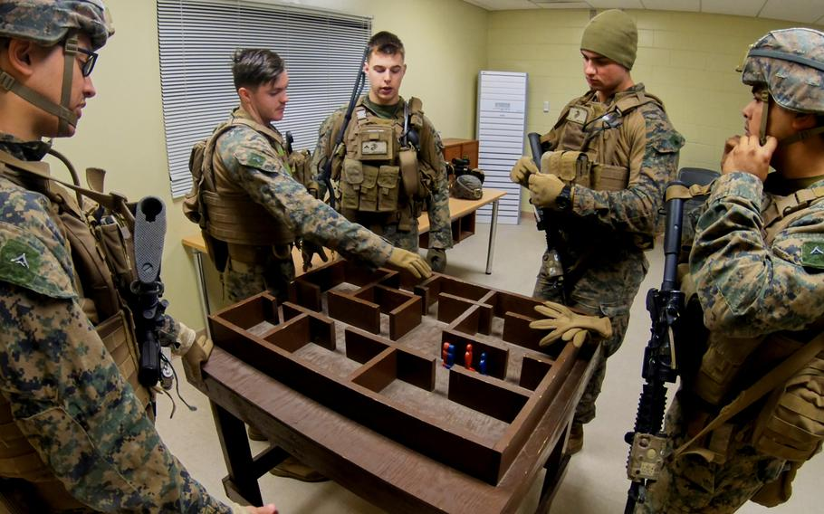 Marines from the Fleet Anti-terrorism Security Team-Pacific, Yokosuka Naval Base, Japan, use a mock-up of the shoot-house to establish a plan for clearing the structure at Story Live Fire Training Complex, South Korea, Tuesday, Nov. 26, 2019.