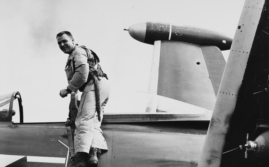 James Holloway stands on a F9F Panther jet fighter in 1953.
