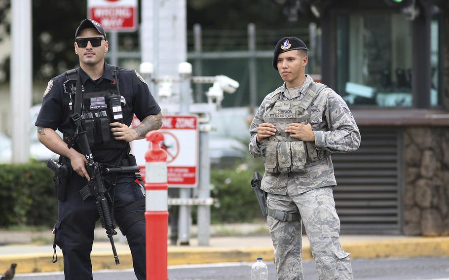 Security stands guard outside the main gate at Joint Base Pearl Harbor-Hickam, in Hawaii, Wednesday, Dec. 4, 2019.