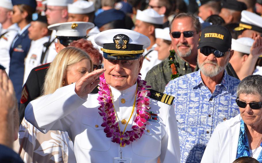 Lou Conter, 98, one of only three living survivors USS Arizona survivors, salutes during the Walk of Honor after a Dec. 7, 2019, ceremony at the Pearl Harbor National Memorial marking the surprise attack 78 years ago.