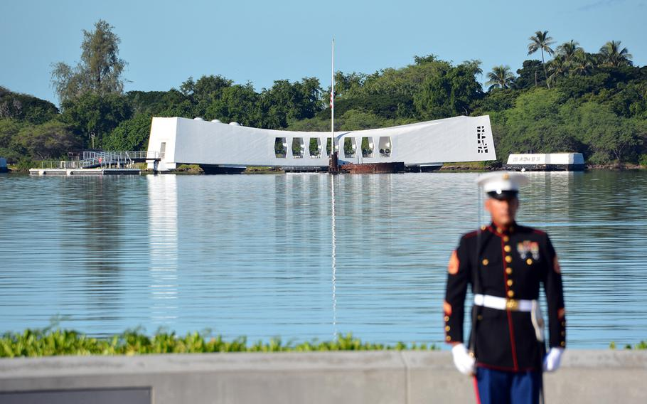 A Marine stands with his back to the USS Arizona Memorial during a rifle salute Dec. 7, 2019, at the Pearl Harbor National Memorial that was part of a ceremony marking the 78th anniversary of the Japanese surprise attack on Oahu.