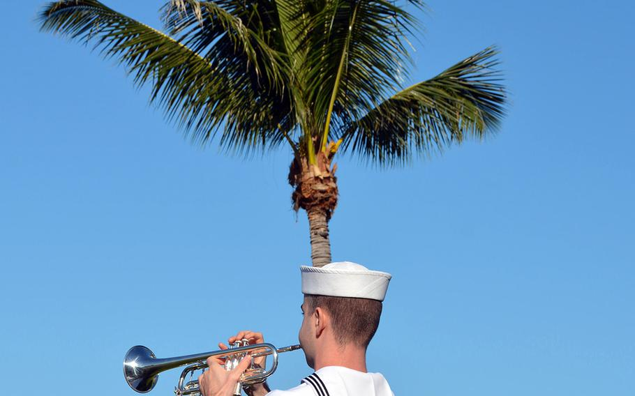 A sailor plays taps Dec. 7, 2019, to honor those who lost their lives during the Japanese surprise attack at Pearl Harbor 78 years ago.