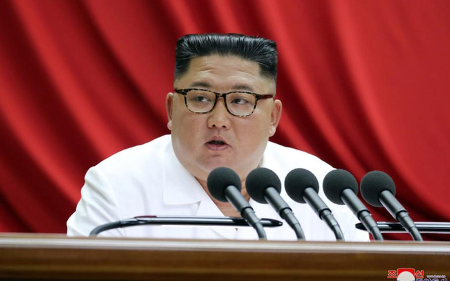 North Korean leader Kim Jong Un speaks at a ruling Workers' Party meeting in Pyongyang on Monday, Dec. 30, 2019.