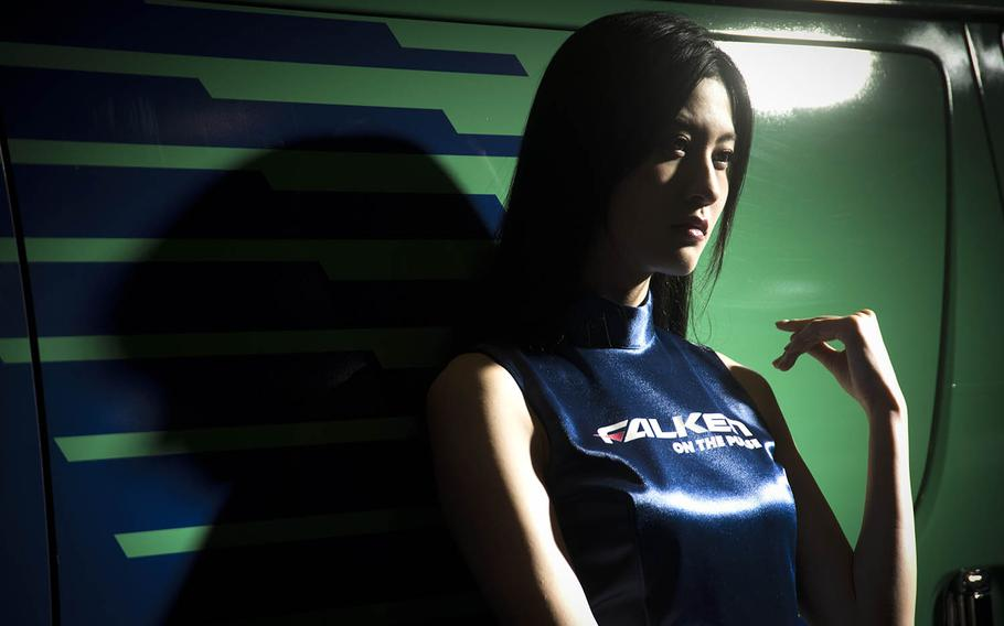 A model working for Falken Tires poses for guests during Tokyo Auto Salon 2020 in Chiba, Japan, Friday, Jan. 10, 2020.