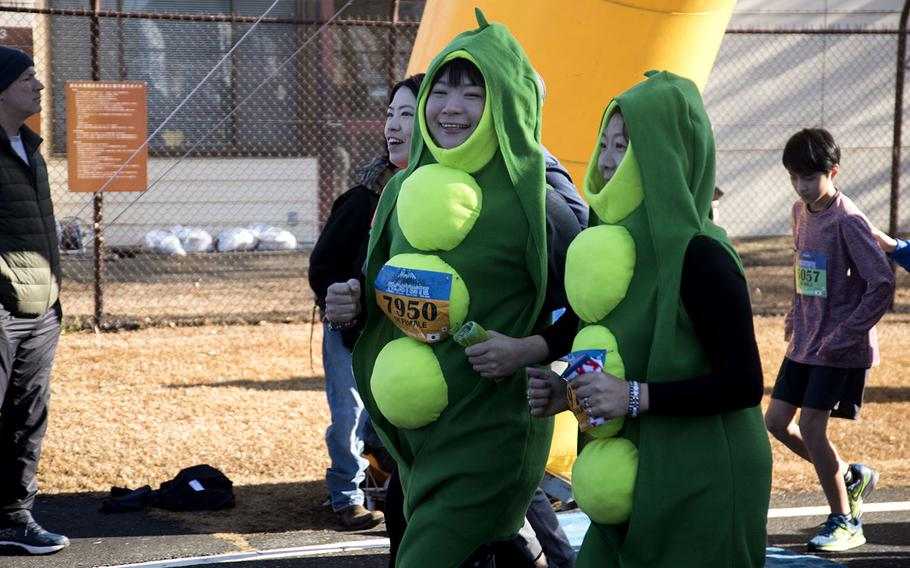 A pair of peapods participate in the 39th annual Yokota Striders Frostbite road race at Yokota Air Base, Japan, Sunday, Jan. 19, 2020.