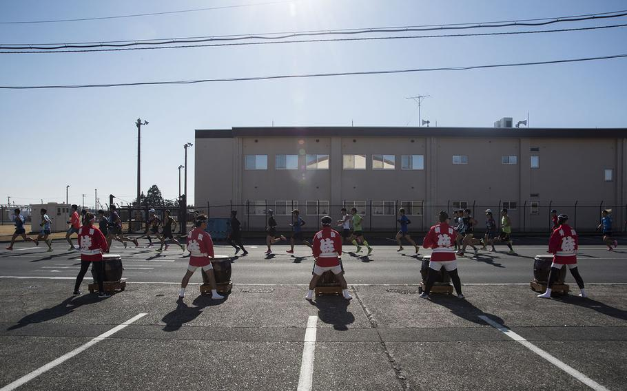 Taiko drummers cheer on runners taking part in the 39th annual Yokota Striders Frostbite road race at Yokota Air Base, Japan, Sunday, Jan. 19, 2020.