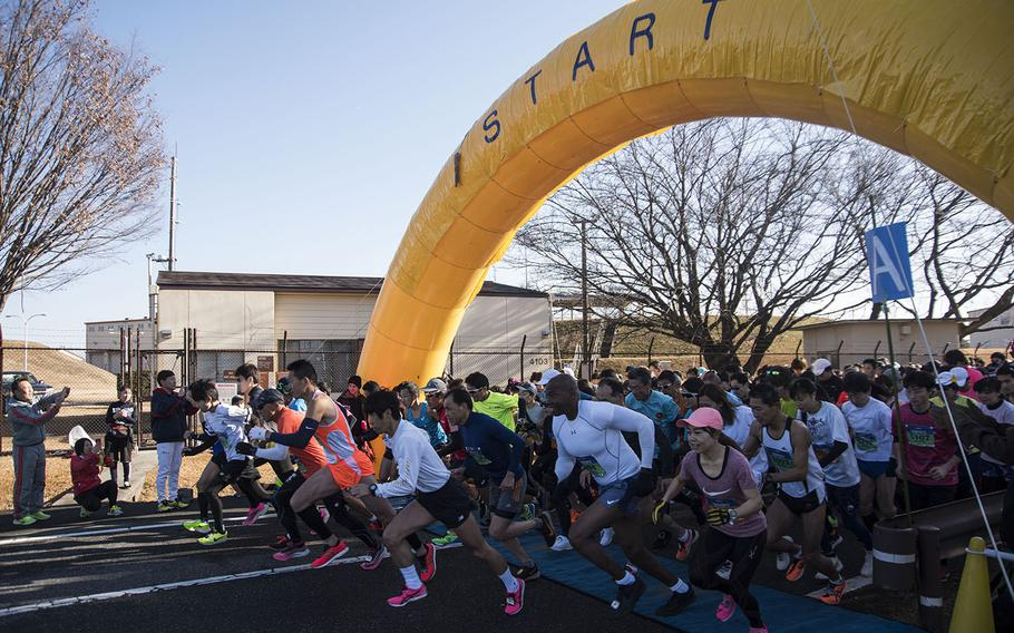 Runners take off from the starting line of the 39th annual Yokota Striders Frostbite road race at Yokota Air Base, Japan, Sunday, Jan. 19, 2020.