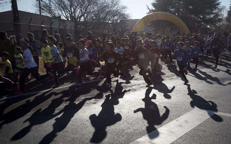 Young runners begin their event during the 39th annual Yokota Striders Frostbite road race at Yokota Air Base, Japan, Sunday, Jan. 19, 2020.