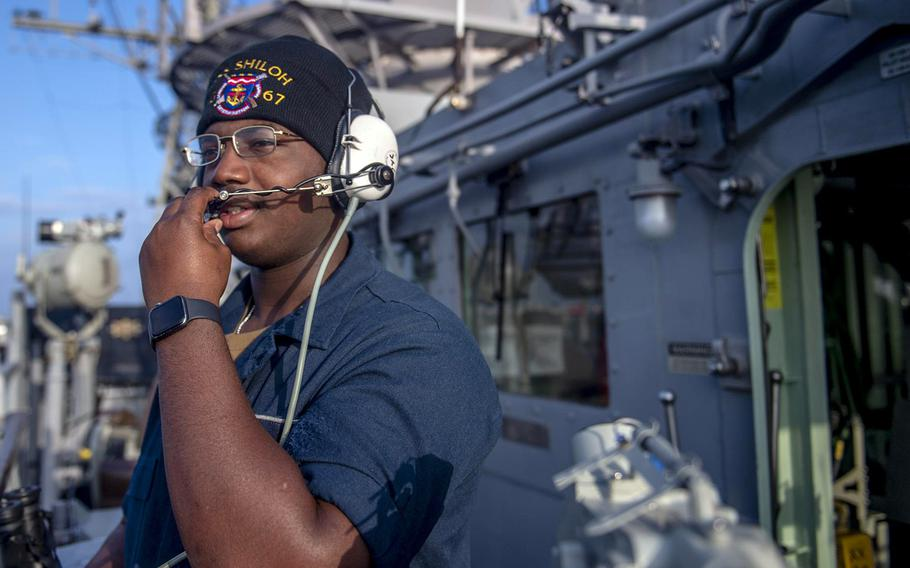 Seaman Marshall Key works aboard the guided-missile cruiser USS Shiloh during a transit of the Taiwan Strait, Thursday, Jan. 16, 2020.