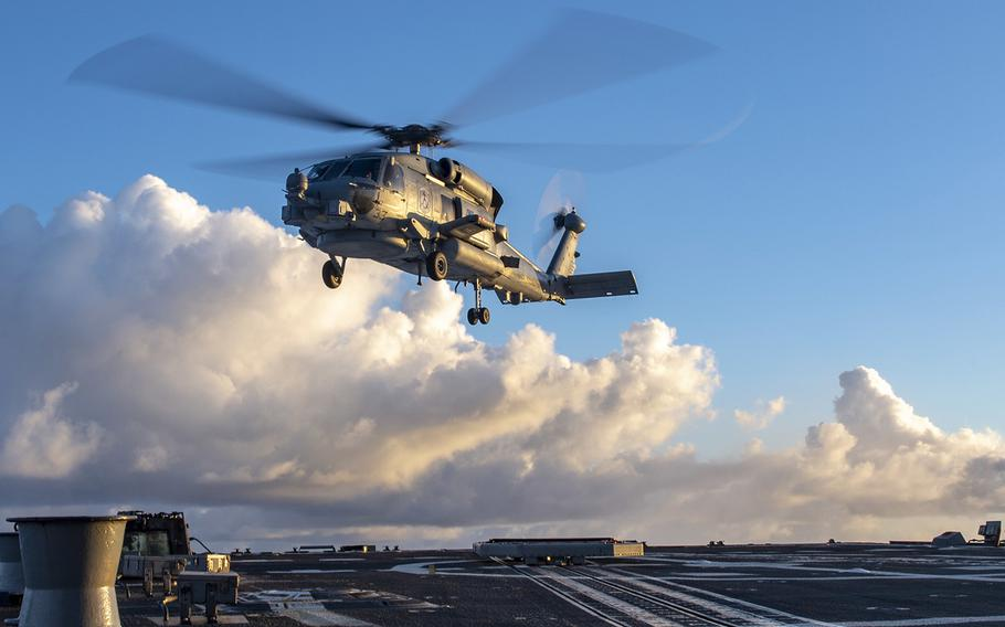A MH-60 Seahawk helicopter takes off in the Indo-Pacific region.