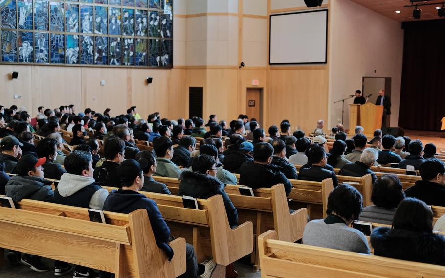 Hundreds of people pack Four Chaplains Memorial Chapel at Camp Humphreys, South Korea, for a town hall meeting about a possible furlough for South Korean base workers, Wednesday, Jan. 29, 2020.