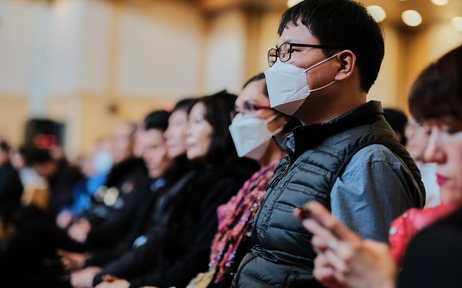 People listen during a town hall meeting about a possible furlough for South Korean base workers at Camp Humphreys, South Korea, Wednesday, Jan. 29, 2020.