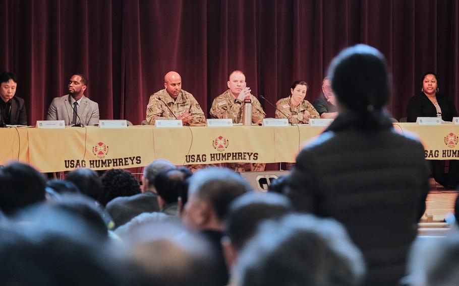 A woman asks a question during a town hall meeting about a possible furlough for South Korean workers at Camp Humphreys, South Korea, Wednesday, Jan. 29, 2020.