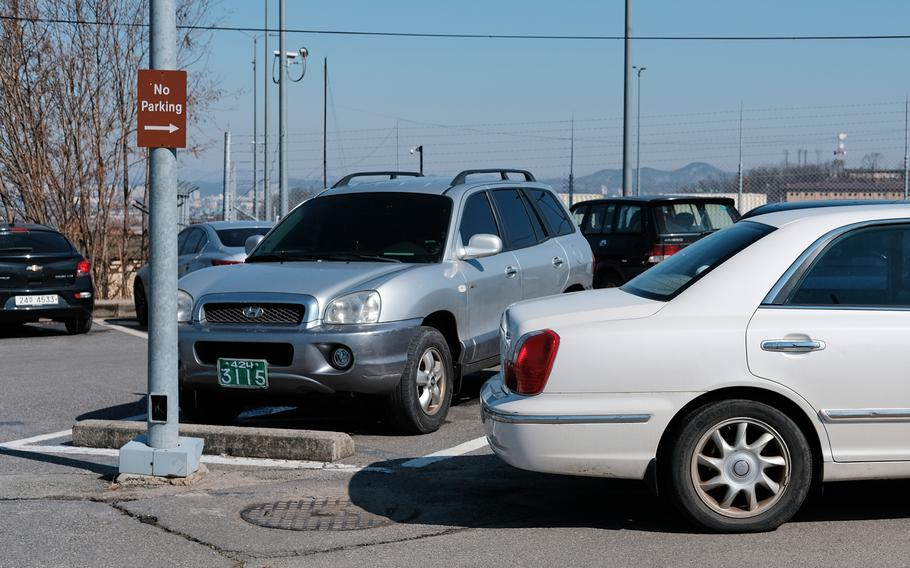 A car is illegally parked near 51st Fighter Wing headquarters at Osan Air Base, South Korea, Tuesday, Feb. 18, 2020.