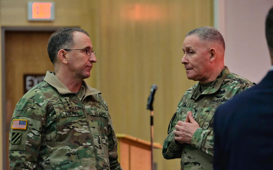 U.S. Forces Korea commander Gen. Robert Abrams and Eighth Army commander Lt. Gen. Michael Bills talk briefly following a town hall-style meeting at the Four Chaplains Memorial Chapel, Camp Humphreys, South Korea, Monday, Feb. 24, 2020.