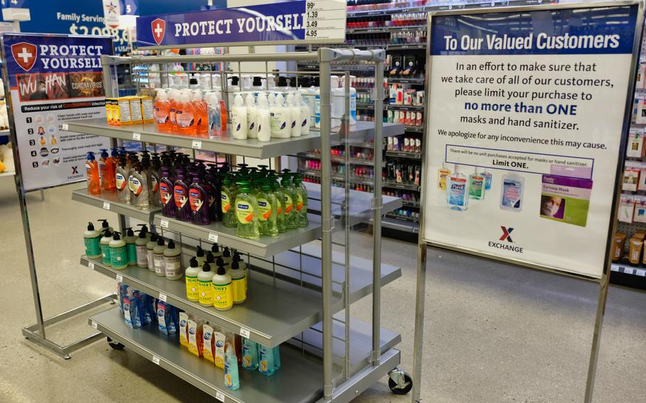 A sign encourages customers to purchase no more than one of various antibacterial soaps and cleaners on the shelf at the Post Exchange at Camp Humphreys, South Korea, Monday, Feb. 24, 2020.