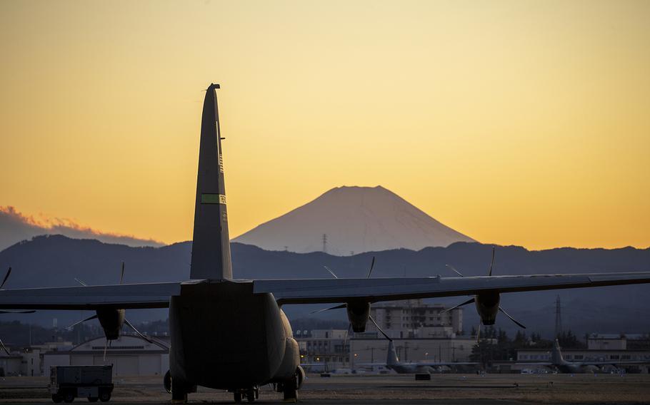 A C-130J Super Hercules sits on the flightline at Yokota Air Base, Japan, with Mount Fuji in the background, Feb. 9, 2020.
