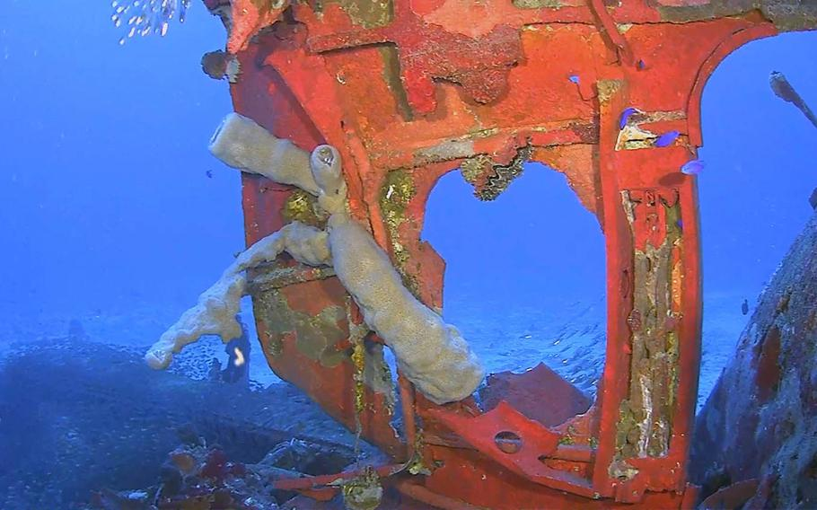 The starboard rear viewing port and entry hatch from a TBM/F-1 Avenger torpedo bomber found during a recent underwater expedition at Truk Lagoon, Federated States of Micronesia.