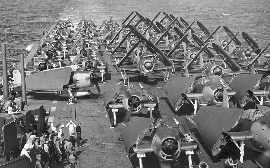 U.S. Avengers, Hellcats, and SBD Dauntless aircraft stand aboard the USS Intrepid carrier in 1944.