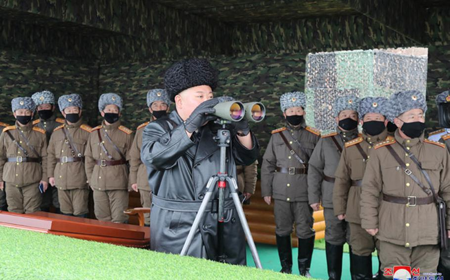 """North Korean leader Kim Jong Un observes a """"joint strike drill,"""" according to the state-run Korean Central News Agency in this undated photo provided by KCNA on Feb. 29, 2020."""