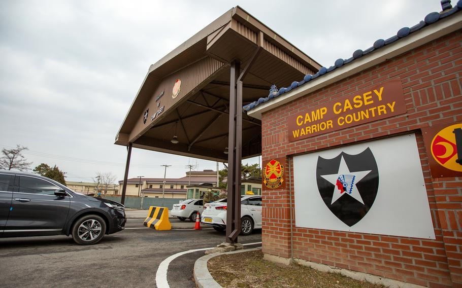Vehicles line up to enter Camp Casey, South Korea, Feb. 26, 2020.
