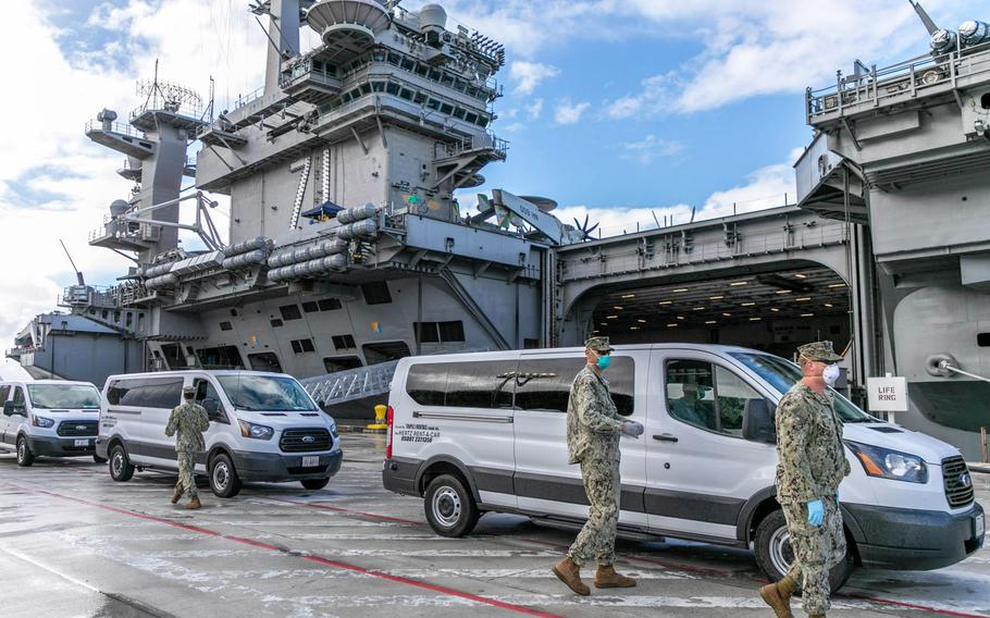 USS Theodore Roosevelt sailors who tested negative for COVID-19 are moved to lodging and quarantine on Guam, April 3, 2020. A sailor assigned to the Roosevelt is in intensive care following complications from a coronavirus infection, the Navy said.