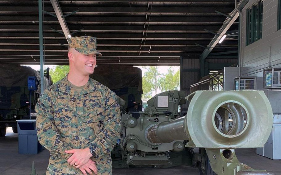 Marine 1st Lt. Kevin Heine of 3rd Battalion, 11th Marine Regiment, stands with an M777 howitzer in Darwin, Australia, after completing a mandatory 14-day self-quarantine on Wednesday, April 8, 2020.