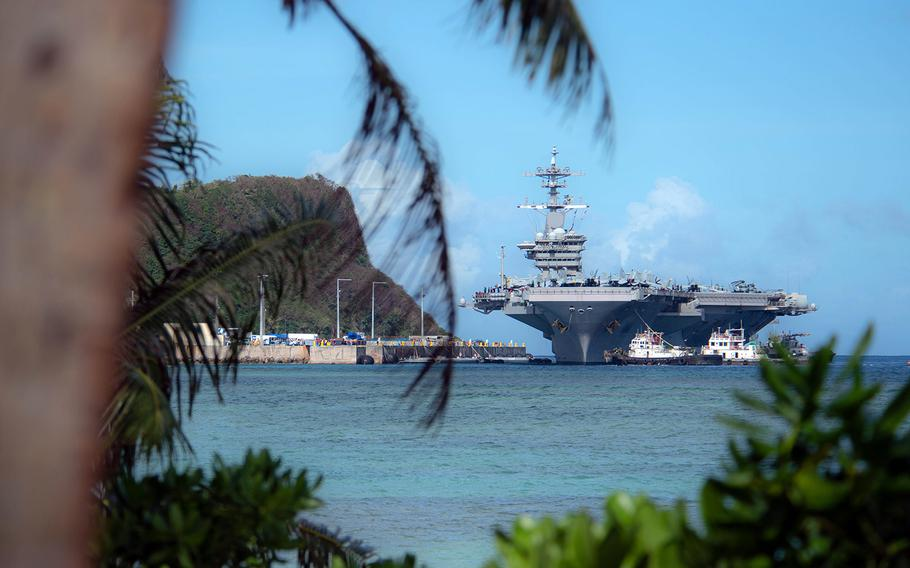 The aircraft carrier USS Theodore Roosevelt prepares to moor on Guam on Feb. 7, 2019.