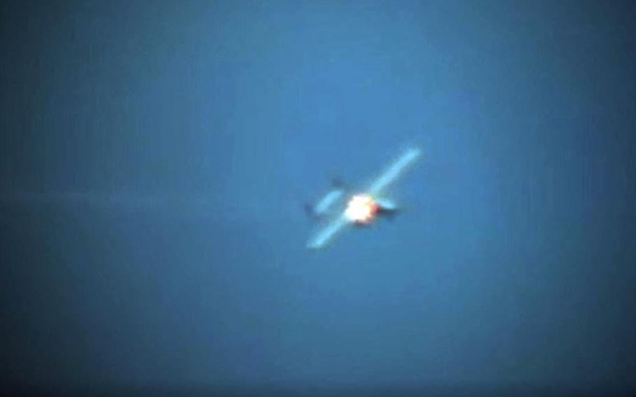 An unmanned aerial vehicle is shot down by a high-energy laser weapon system known as an LWSD fired by the USS Portland somewhere in the Pacific on May 16, 2020.