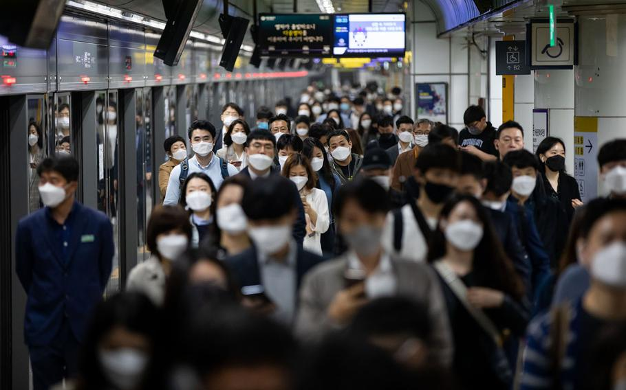 Passengers in a subway station in Seoul, South Korea, on May 18, 2020.
