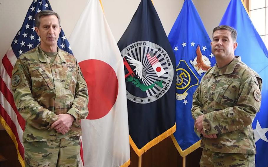 U.S. Forces Japan commander Lt. Gen. Kevin Schneider, left, and senior enlisted leader Chief Master Sgt. Rick Winegardner Jr. discuss the command's health-protection level in a video posted to Facebook, Friday, June 12, 2020.