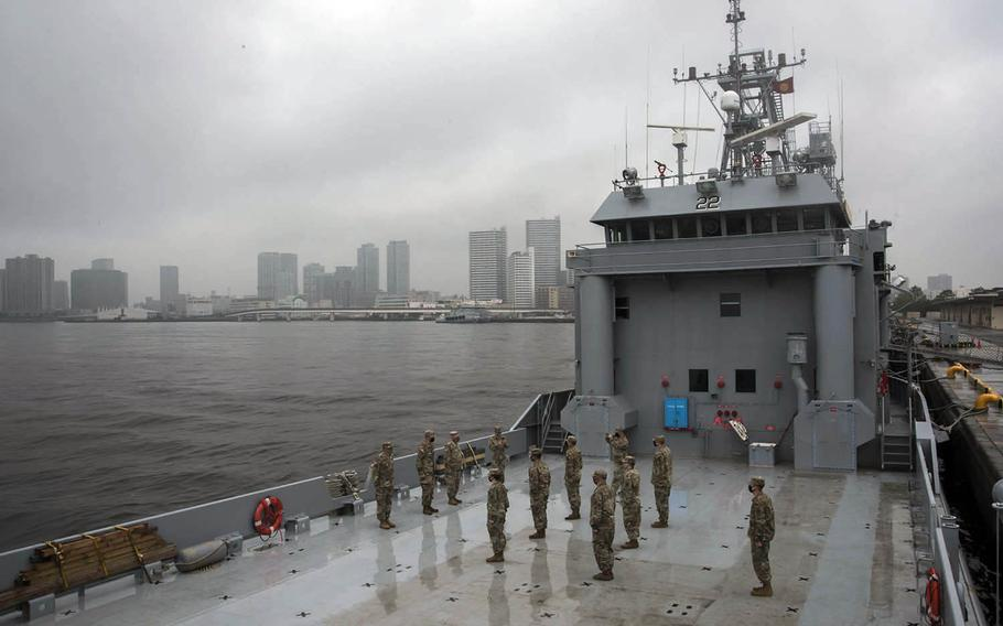 Soldiers take part in a promotion ceremony and celebrate the Army's 245th birthday aboard the Army Vessel Harpers Ferry at Yokohama North Dock, Japan, Sunday, June 14, 2020.