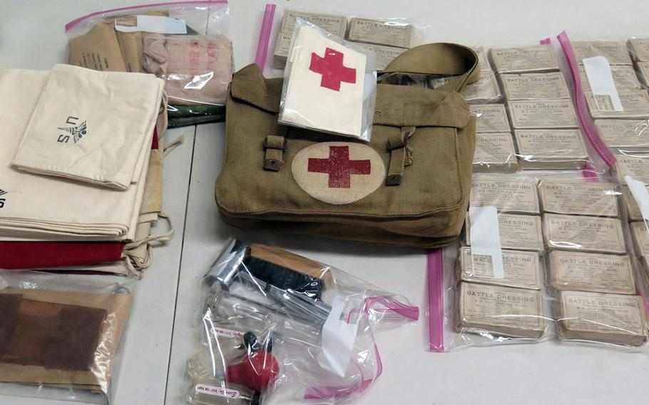 A Red Cross flag and other World War II-era medical supplies are being auctioned from the extensive military collection of the Home of the Brave museum in Honolulu.