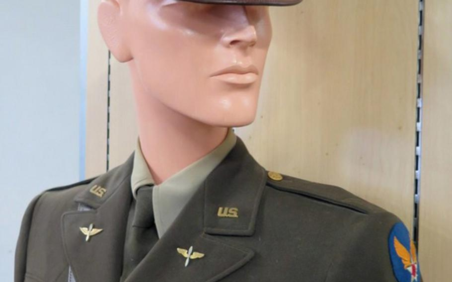 A full World War II-era Army Air Corps uniform, complete with insignia, shirt, pants, tie and hat, is among the uniforms being auctioned from the collection of the Home of the Brave museum in Honolulu.