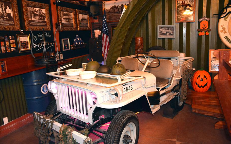 This 1942 Willys Jeep, which has no engine or transmission, was centerpiece decor at the Home of the Brave brew pub in Honolulu.