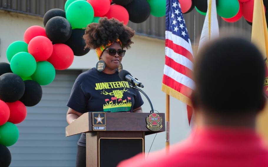 Domenique Marie, founder of the first-ever Juneteenth celebration at Camp Humphreys, South Korea, speaks to the nearly 1,000 people in attendance on Friday, June 19, 2020.