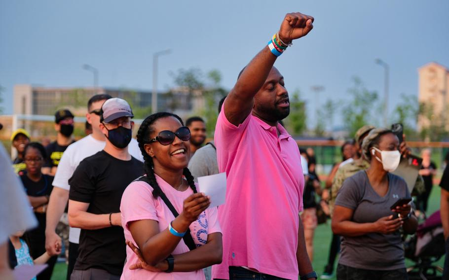 """People listen and sing along to a performance of """"Lift Every Voice and Sing"""" during the inaugural Juneteenth celebration at Camp Humphreys, South Korea, Friday, June 19, 2020."""