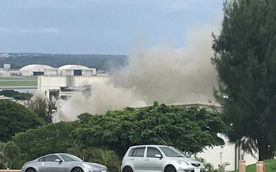 Smoke rises from a fire that started at a hazardous materials building at Kadena Air Base, Japan, Monday,  June 22, 2020.