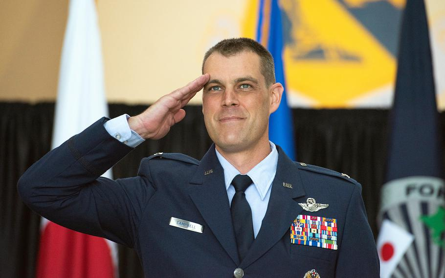 Col. Andrew Campbell salutes after taking command of the 374th Airlift Wing at Yokota Air Base, Japan, Monday, June 22, 2020.