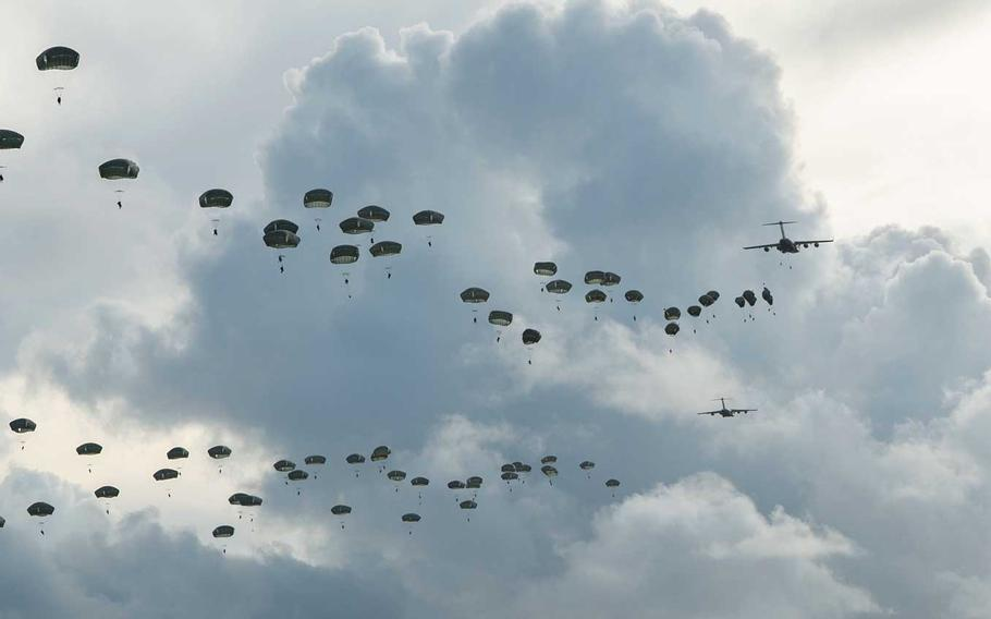Hundreds of paratroopers assigned to U.S. Army Alaska jump onto Andersen Air Force Base, Guam, Tuesday, June 30, 2020.