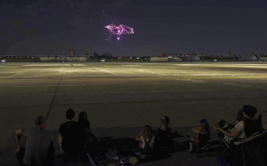 Families watch a fireworks show at Yokota Air Base in western Tokyo, Thursday, July 2, 2020.