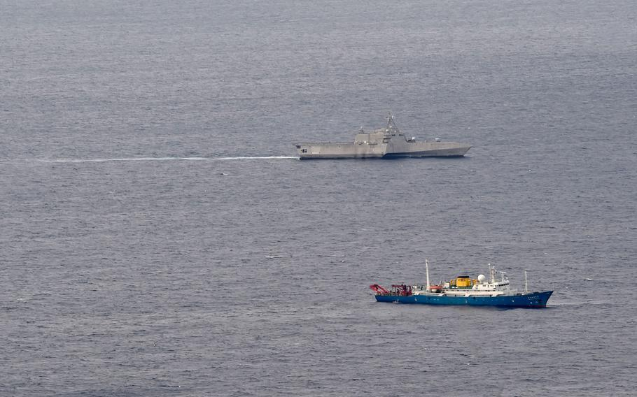 The littoral combat ship USS Gabrielle Giffords conducts routine operations in the vicinity of the Chinese vessel Hai Yang Di Zhi 4 Hao, shown in the foreground, in the South China Sea July 1, 2020.